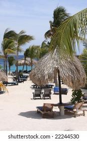 Caribbean beach parasols and sun chairs