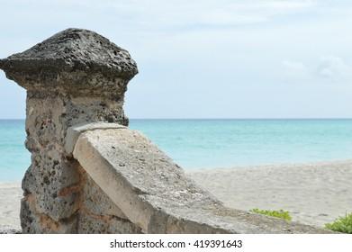 caribbean beach and stone wall