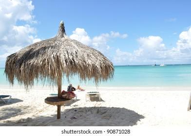 Caribbean beach with umbrella hut