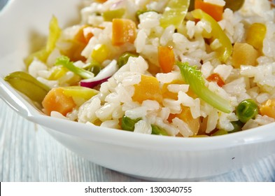 Caribbean Confetti Rice, fragrant coconut rice recipe loaded with chiles, sweet peppers, pineapple, cilantro, and spices
