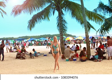 CARIBBEAN – DOMINICAN REPUBLIC – FEBRUARY 2017 - Lenka Kopalova on the beach in Boca Chica (Santo Domingo) with Dominican and Haitian people on Public Holiday - Independence Day.