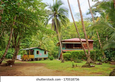 Caribbean house and hut with tropical vegetation, Gandoca Manzanillo national wildlife refuge, Limon, Costa Rica