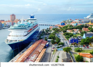The Caribbean. The Island Of Curacao. Port. The island of Curacao attracts hundreds of thousands of passengers of cruise ships. 2 berth mooring cruise liners.