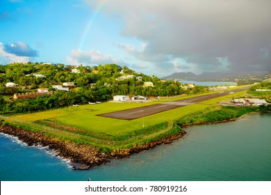 The Caribbean. The Island Of St Lucia. A landing strip of the airport. The island has two airports. Landing strip starts right at the edge of the sea.