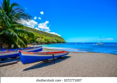 Caribbean Martinique beach beside traditional fishing boats