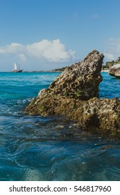 Caribbean ocean with pirate ship in the background