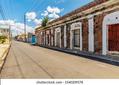 Caribbean old city street, antique victorian building, tropical, palm tree, Puerto Plata, Dominican Republic