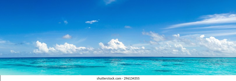 Caribbean panorama Hawaiian Maldivian Bahamian coast with a boat in a turquoise tropical sea. Siladen turquoise tropical paradise island in Indonesia landscape panorama. Panorama of sea waves.