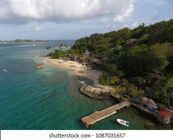 Caribbean Resorts are amazing: Young Island with small jetty and Hotels, St Vincent and the Grenadines - 4 May 2018