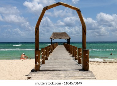Caribbean sea beach, wooden pier.