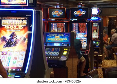 CARIBBEAN SEA - DEC 20, 2017 - Slot machines  in the casino on a cruise ship in the  Caribbean Sea