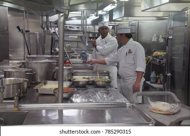 CARIBBEAN SEA - DEC 20, 2017 - Kitchen crew work in the  galley of a cruise ship in the Caribbean Sea