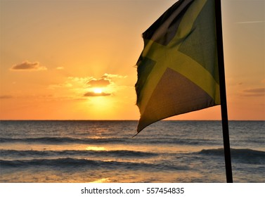 Caribbean sea flag sunset