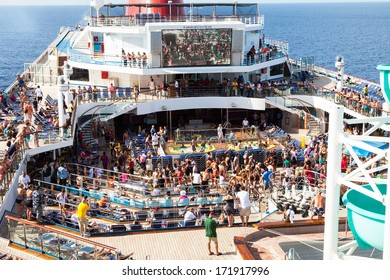 Caribbean Sea, July 10, 2011: Passengers aboard the Carnival Freedom gather on the Lido Deck at the start of a Caribbean cruise.