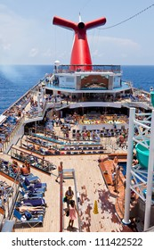 CARIBBEAN SEA - JULY 17: Passengers on Carnival begin a 7-day Eastern Caribbean cruise on July 17, 2011.  The ship is the fifth and final incarnation of Carnival's highly successful Conquest class.