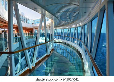 CARIBBEAN SEA - MARCH 29, 2017 : Glass floor seawalk over the sea on Royal Princess ship. Royal Princess is operated by Princess Cruises line and has a capacity of 3600 passengers