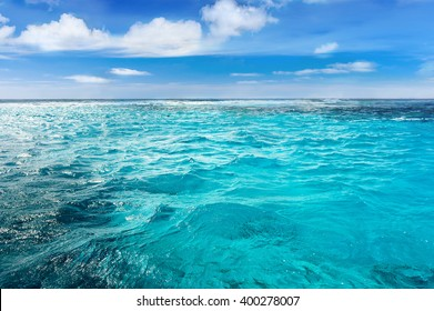 Caribbean sea surface summer wave background. Exotic water landscape with clouds on horizon. Natural tropical water paradise. Cuba nature relax. Travel tropical island resort. Ocean nature tranquility - Shutterstock ID 400278007