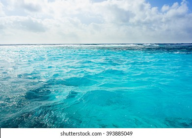 Caribbean summer sea with blue water wave, Cuba. Outdoor tropical summer sea paradise. Heaven view of deep transparent ocean. Sunshine reflection on a calm summer ocean. Tranquility of turquoise water