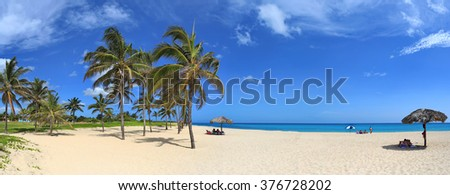 Caribbean tropical beach with beautiful white sand, turquoise water and palm trees in Tarara (Havana, Cuba). Panoramic view
