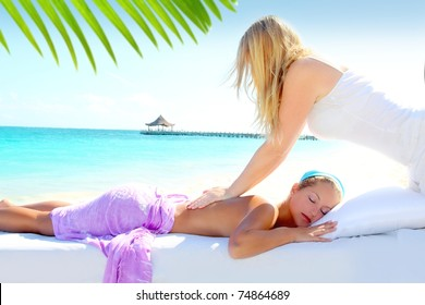 Caribbean turquoise beach chiropractic massage therapy woman [Photo Illustration]