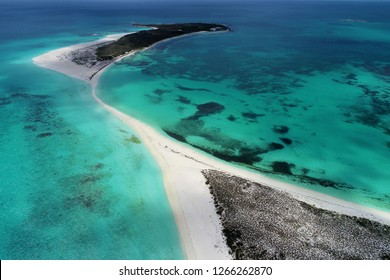 Caribbean: Vacation in the blue sea and deserted islands. Aerial view of a blue sea with crystal water. Great landscape. Beach scene. Caribbean scene. Paradisiac. Deserted. Travel. Resort.