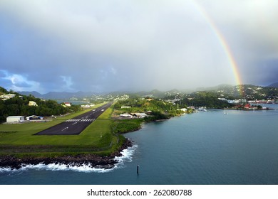 The Caribs. The Island Of Saint Lucia. Rainbow over the airfield. Saint Lucia is the most beautiful island in the Caribbean sea. The runway starts at the edge of the sea.