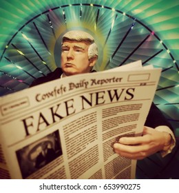 Caricature of United States President Donald Trump reading a Fake News newspaper - action figure toy