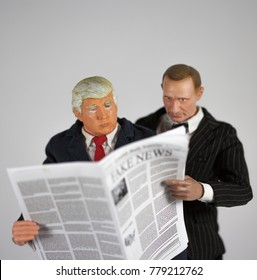 Caricature of United States President Donald Trump and Russian President Vladimir Putin reading Fake News