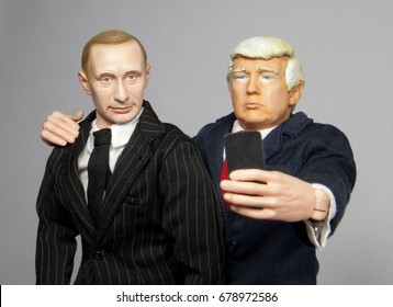 Caricature of US President Donald Trump and Russian President Vladimir Putin taking a selfie - using toy action figures