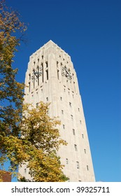 carillon bell tower with clock against blue sky - fall