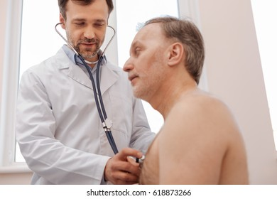 Caring competent doctor making sure his patient being healthy