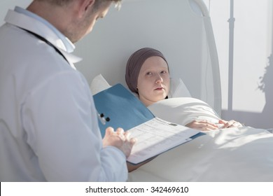 Caring doctor analyzing medical results of patient with cancer