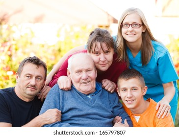 Caring doctor together with her patient's family.