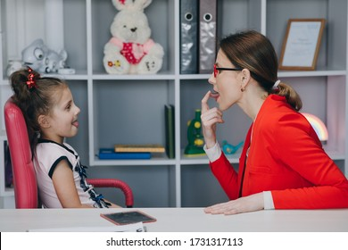 Caring mom or female speech and language therapist teaching stuttering cute preschooler child girl daughter learning correct pronunciation having stutter difficulty voice ability problem concept