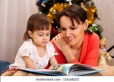 Caring mother decided to read to her child an interesting book on Christmas Eve