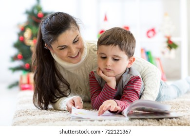 Caring mother reads to her child an interesting book on Christmas Eve