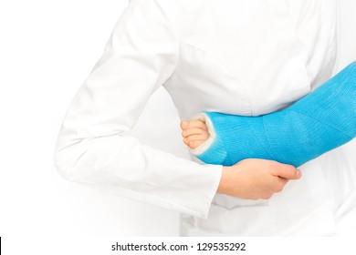 Caring nurse taking care of broken leg of boy