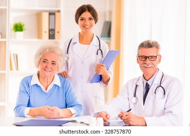 Caring for a sick senior woman in hospital