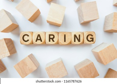 Caring word on wooden cubes