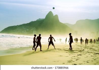 Carioca Brazilians playing altinho futebol beach football kicking soccer ball Ipanema Beach Rio de Janeiro
