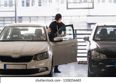 Carjacker is stealing a car successfully