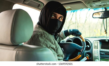 carjacking, the thief sits behind the wheel
