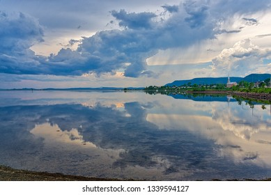 CARLETON QC/CANADA JUNE 29 2018 A dramatic sky perfectly reflected in the lagoon at Carleton in Gaspesie, Quebec