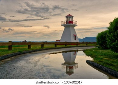 CARLETON QC/CANADA JUNE 29 2018 The lighthouse at Carleton, Gaspesie, Quebec reflected in a puddle after a summer storm
