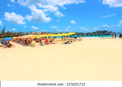 Carlisle Bay, Barbados, Caribbean - February 25th 2018: Tourists relax and soak up the sun at the popular Carlisle Bay beach resort in Barbados.