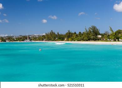 Carlisle Bay is a small natural harbor located in the southwest region of Barbados. Many relics, like anchors and cannonballs, from ships can be found on the ocean floor in Carlisle Bay.
