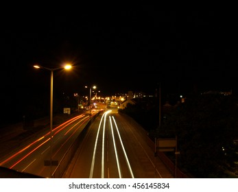 Carlisle City Centre at Night with Car Headlights, using Slow Shutter Speed, on the Bridge over Castle Way, beside Tullie House Museum - Cumbria, England