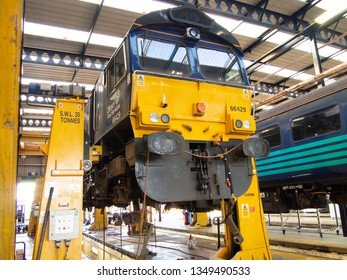 Carlisle, Cumbria/UK - March 25 2019: Class 66 Loco gets service on the day introduction of the new locos at the DRS Carlisle engine sheds.