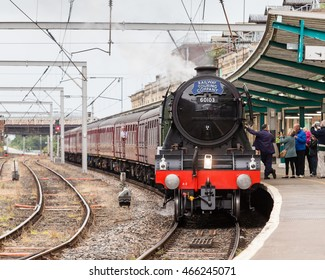 CARLISLE, ENGLAND - AUGUST 7:  The Flying Scotsman, a preserved steam locomotive, heads The Waverley in Carlisle Citadel station in Cumbria on August 7, 2016.