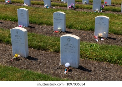 Carlisle, PA, USA - June 26, 2016: Graves of Native American youths that attended the Carlisle Indian Industrial School in Carlisle.